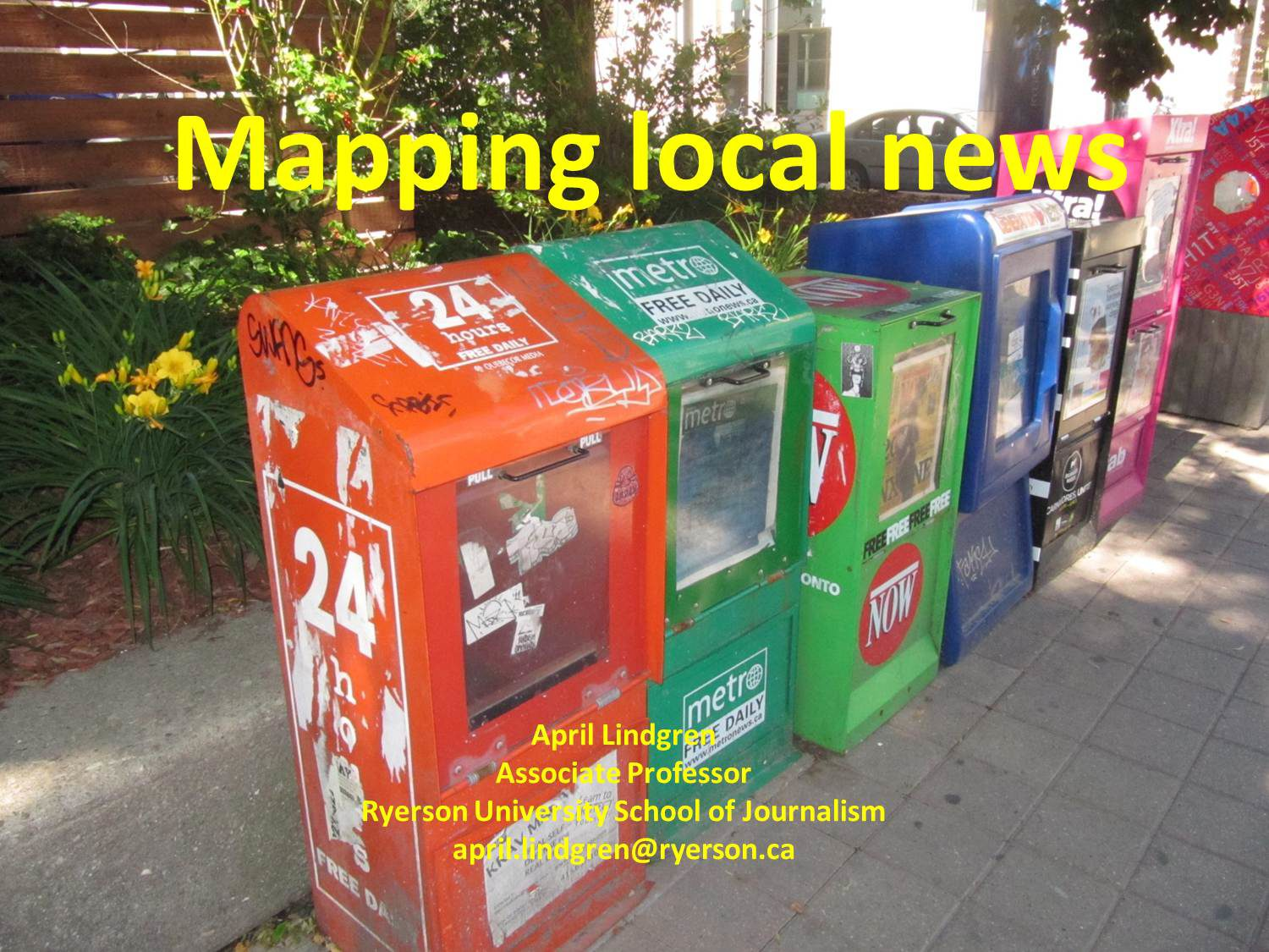Image of news stands and headline that reads mapping local news
