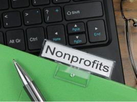 A keyboard, pen and green folder with the title Nonprofits